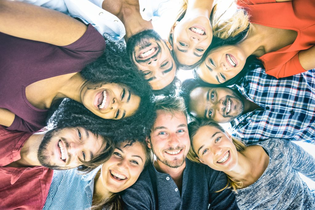 Sempris Multiracial best friends millennials taking selfie outdoors with back lighting - Happy youth friendship concept against racism with international young people having fun together - Azure filter tone